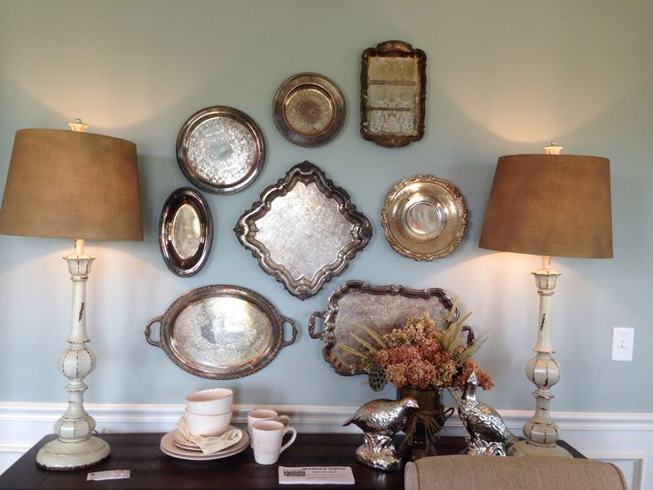 Found this look at the St. Jude Dream Home. Love the old silver trays hanging on the wall. GREAT idea!!
