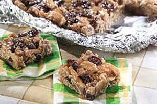 Ideal for busy days, these no-bake bars of warm honey and peanut butter poured over shredded wheat cereal and raisins are pressed in a pan and cooled.