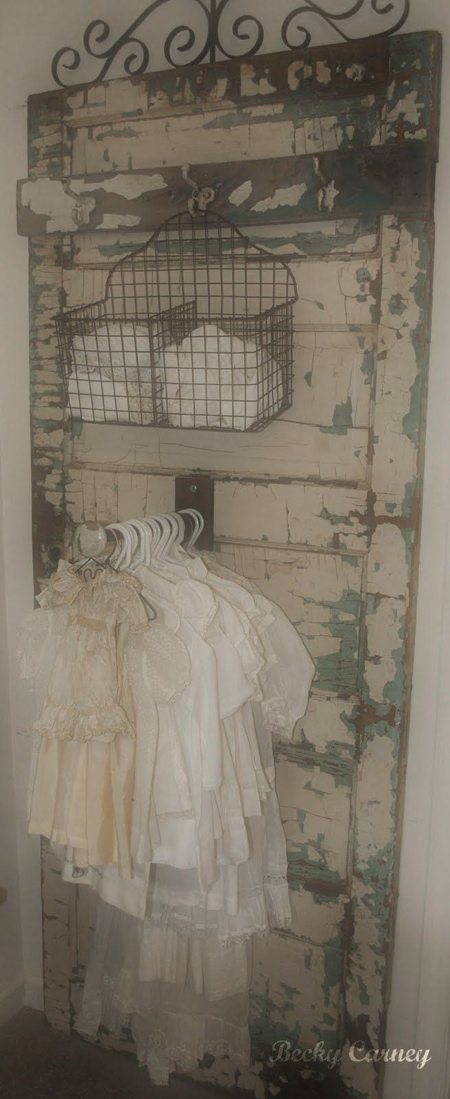 Linove love love love.  Vintage Chippy Wooden Door From Which Vintage Children's Clothing Is Hung