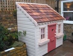 Pretty little cedar shingle playhouse with doorbell, letterbox, window boxes and even matching curtains. Perfect for a small space.