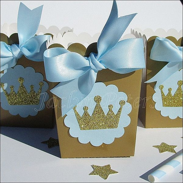 Our hand made baby blue and gold glitter crown popcorn favor boxes are perfect for a baby shower or his first birthday party. Add sparkle to your dessert table or fill with your own candy treats and g