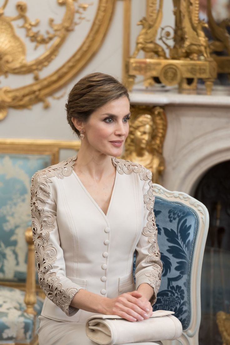 Queen Letizia looked regal in her cream coloured outfit.