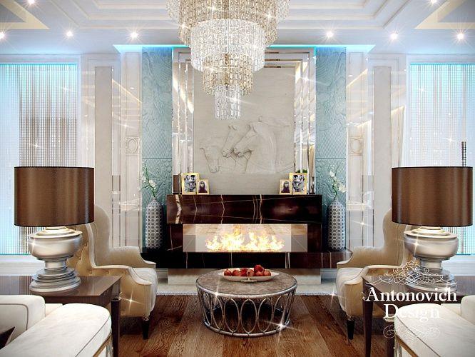 Дизайн гостиной. Настоящий камин приглашает посидеть в уютном кресле с чашечкой ароматного чая.