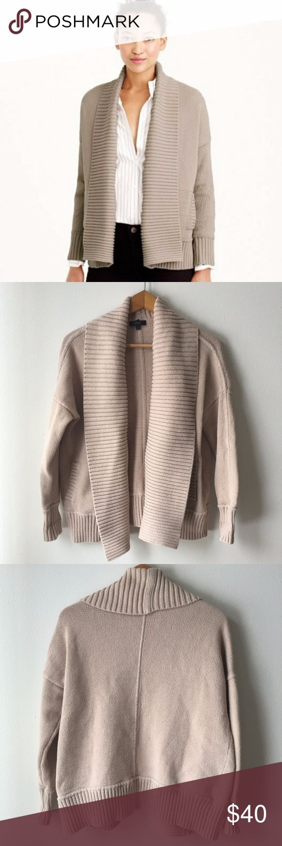"""J. Crew Chunky Trim Open Cardigan Sweater This cozy cardigan boasts an easy silhouette with a shawl collar and a chunky rib knit. A superwarm pick that's polished enough for work but comfy enough for lazy Sundays with the Times—it's the one you'll reach for again and again.  -Cotton/nylon. -Rib trim at neck, cuffs and hem. -Patch pockets. -Loose fit. -Hits slightly below hip.  Good condition, no flaws.  Approximate Measurements Flat: Pit to Pit: 22"""", Should to Hem: 25"""" J. Crew Sweaters…"""