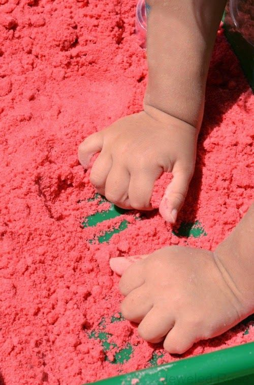 Watermelon Moon Sand Recipe- If you are unfamiliar with moon sand it is truly amazing stuff.  It is mold-able but crumbly and produces the b...