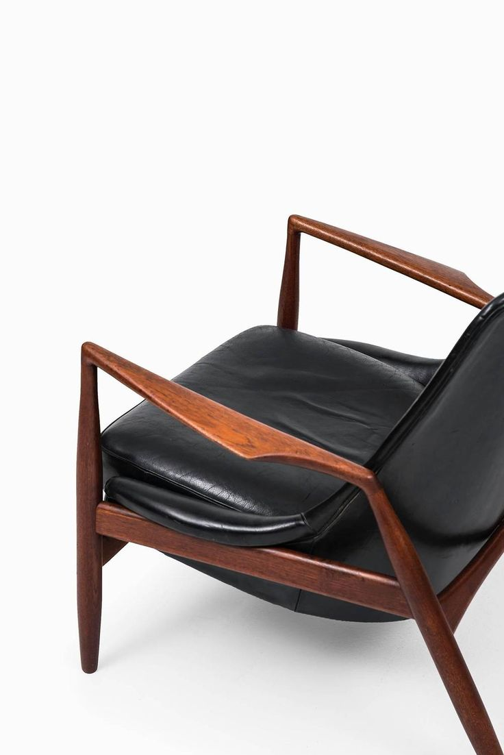 Ib Kofod-Larsen Seal Easy Chairs by OPE in Sweden | From a unique collection of antique and modern lounge chairs at https://www.1stdibs.com/furniture/seating/lounge-chairs/