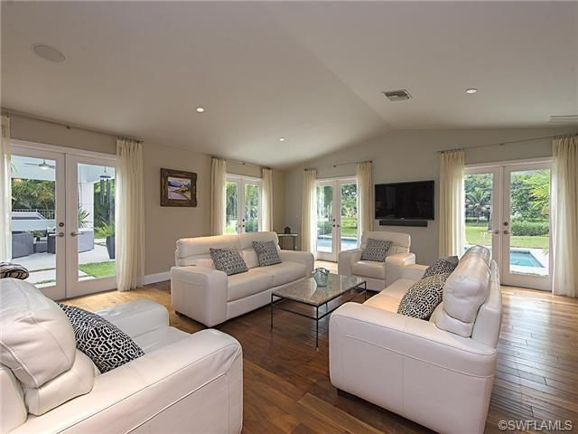 Delightful Contemporary Transitional Living Room   Wood Floors   White Leather Sofas  And Chairs. Four Seasons