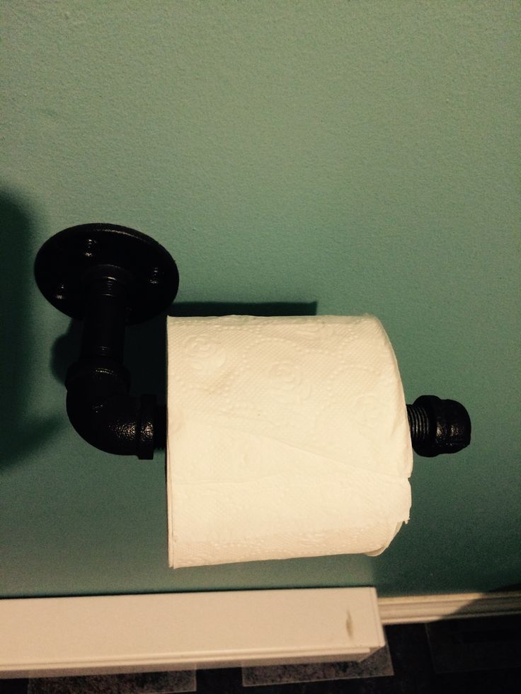 DIY paper toilet holder with piping in nautical bathroom