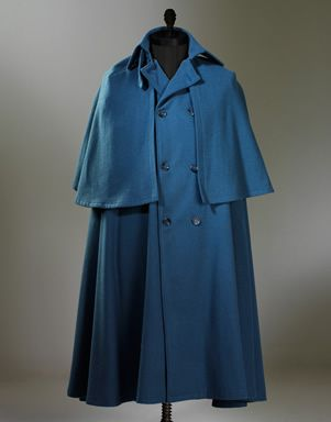 Inverness cape- a large, loose overcoat with full sleeves and a cape ending at wrist length.