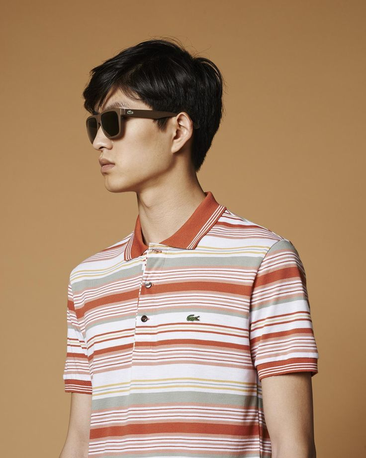The polo scores an elegant win with engineered stripes in a clay-toned palette.