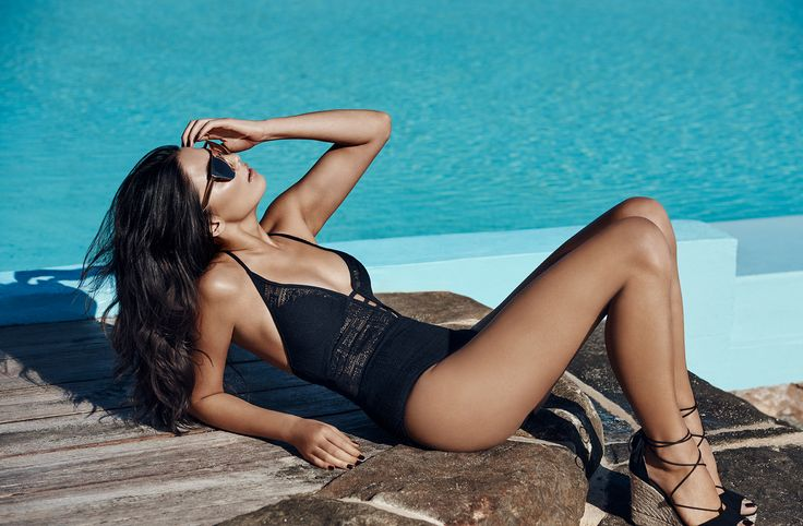 The JETS Swimwear plunge lace one-piece pictured on Jessica Gomes | This lace creation forms goddess status with a fixed tab front detail and panelled lace inserts. Take the plunge and shop this new season one-piece swimsuit, you're sure to impress on your next vacay escape.