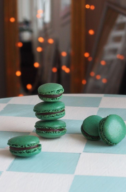 Green macarons with chocolate ganache