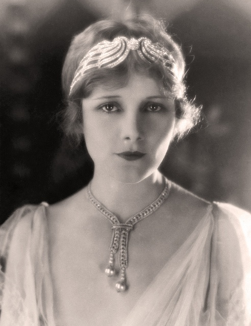 Jeanne Eagels (1890-1929) - American actress on Broadway and in several motion pictures.  She was a former Ziegfeld Follies Girl who went on to greater fame on Broadway and in the emerging medium of sound films.  Died young.  This picture is a publicity shot from Metro Goldwyn Mayer from the 1920s.