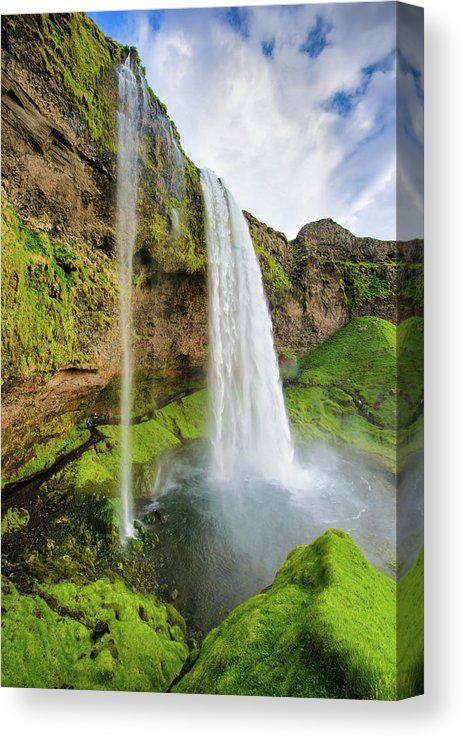 Waterfall Canvas Print for sale. Seljalandsfoss in South Iceland, beautiful green landscape. The image gets printed on one of our premium canvases and then stretched on a wooden frame, click through and check out your options. 30 days money back guarantee. Matthias Hauser - Art for your Home Decor and Interior Design.