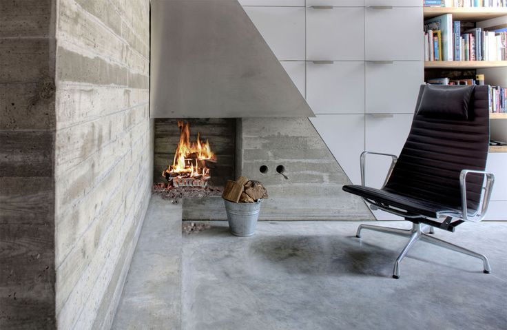 concrete fireplace with polished concrete floor
