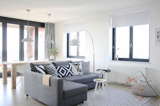 Bright Gray Sectional Sofa Decorated with Patterned Pillows in Black and White Coupled with White Wooden Stools