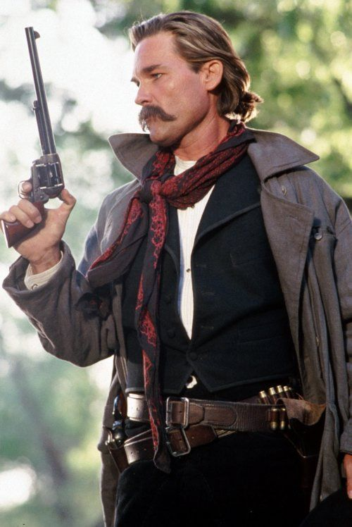 Kurt Russell as Wyatt Earp in Tombstone.  Good shot for details of his costume…