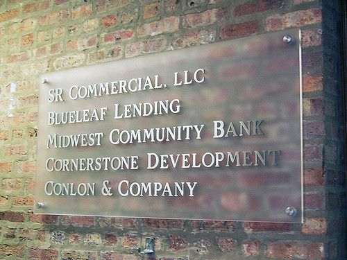 Frosted acrylic panel with brushed aluminum letters assembled.
