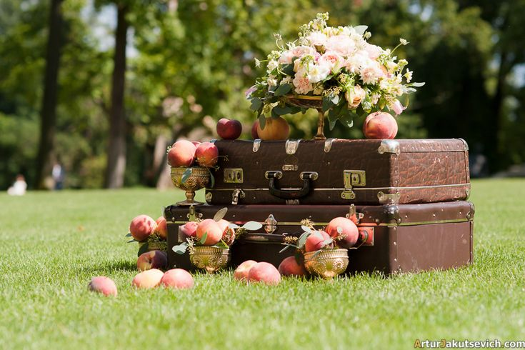 Vintage designer suitcases decorated with peaches and roses