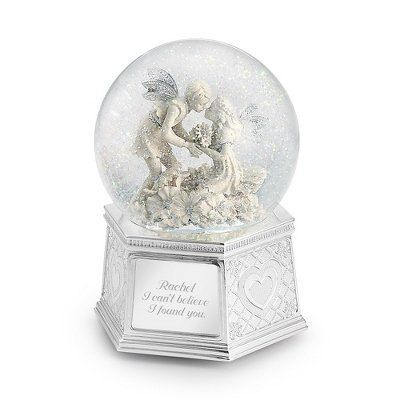 Personalized Girl And Boy Fairy Snow Globe Gift by Things Remembered. $39.99. Fairies are thought to have magical powers, so the beauty of this handcrafted piece will certainly cast a spell on all who see it. Two highly ornate fairies with delicate silver-plated wings have been captured in a tender moment. Your words will also add a magical touch, creating memories that will last forever. Plays Waltz of the Flowers and rotates. The silver plated base is detailed wi...