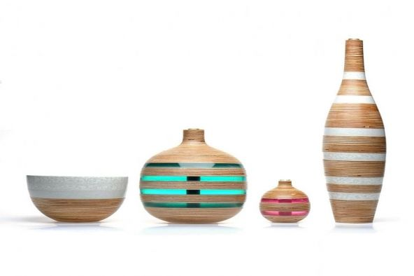Manchester, England's Sarah Thirlwell combines her talent in traditional wood turning (FSC certified wood mind you) with sourcing and integrating recycled and reclaimed materials such as yogurt containers, vending cups and reclaimed acrylic to make vessels, vases, jewelry and larger scale installations.