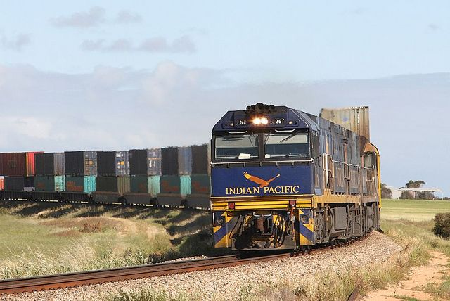 Australia - A Pacific National Melbourne to Perth intermodal services nears Long Plains in South Australia. The leading NR class is one of several specially painted for use on Sydney to Perth Indian Pacific passenger services - by Bingley Hall, via Flickr