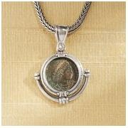 Ancient roman coin necklace. The coin flips showing both sides. Very nice.