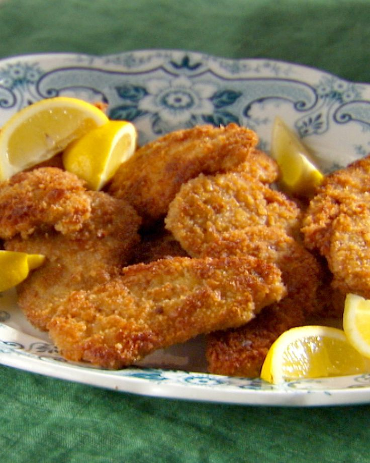 In this updated version of classic pork schnitzel, thin slices of pork tenderloin are coated in Dijon-mustard-infused eggs before being breaded and fried until golden.
