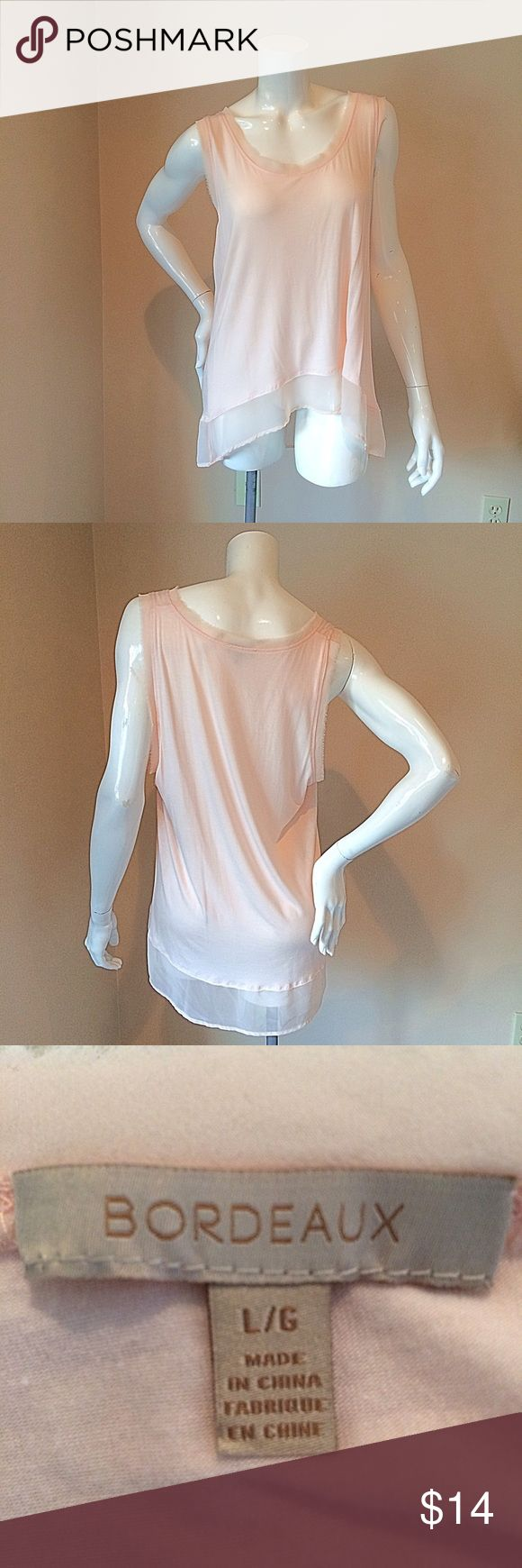 Bodeaux Anthropologie  L peach jersey flounce tank Bordeaux Anthro size large peach jersey flounce tank. Bust 20 inches, length 27 inches. 94% rayon 6% spandex. Wear this a skinny jeans and heels for a super sweet relaxed look. Anthropologie Tops Tank Tops
