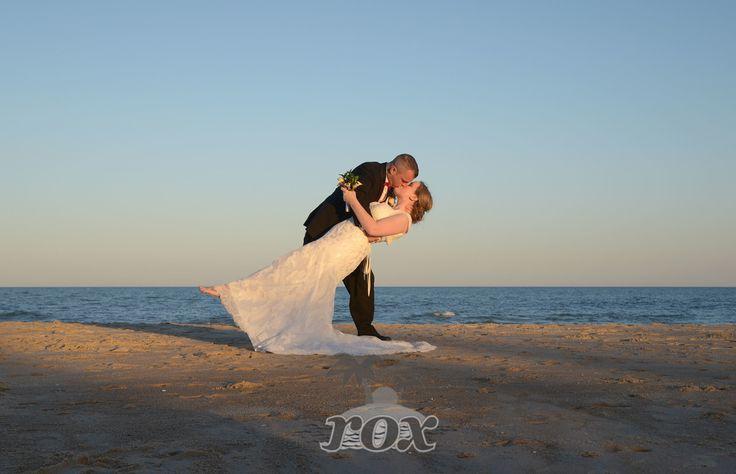 Perfect beach wedding kiss - image by Rox Beach Weddings of Ocean City, MD: https://www.oceancitybeachwedding.com/