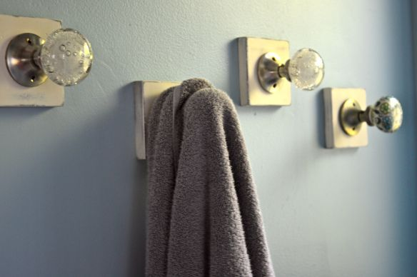 Antropologie doorknobs repurposed as towel holders! Love it!   Barbells and Buttercream