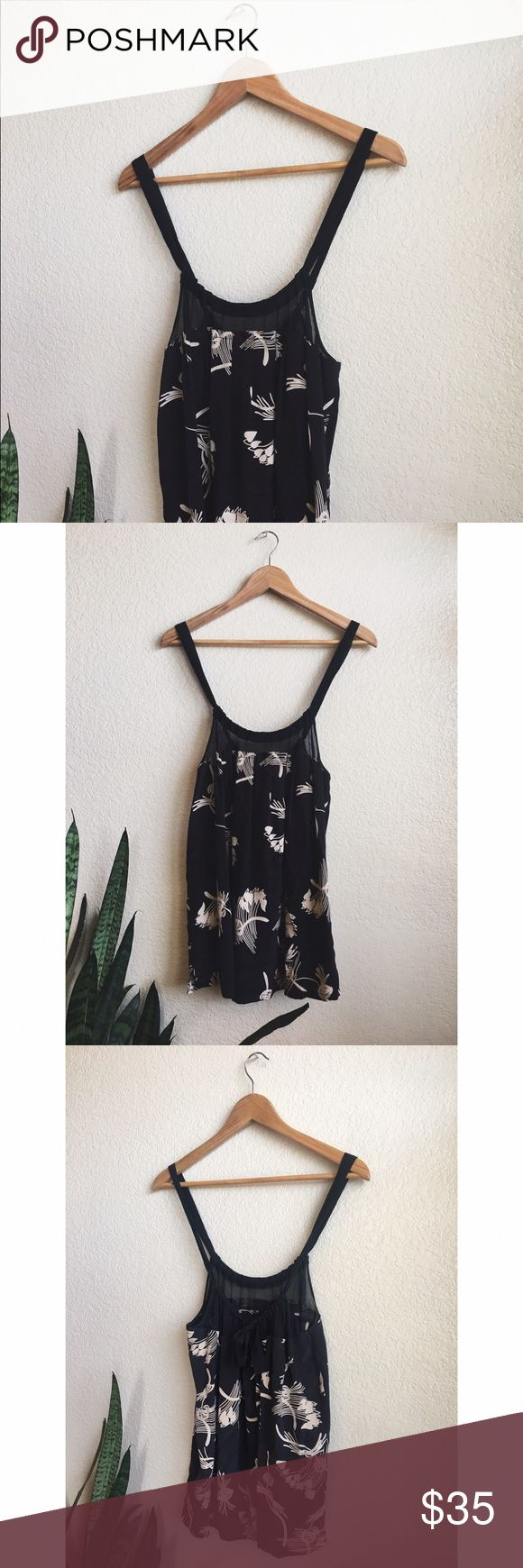 JOIE silk tank top black and white Joie tank top. 100% silk w modern floral-esqe pattern. bow accent. excellent condition, barely worn. light wrinkling just from storage. comes from a clean, smoke-free, and loving home. Joie Tops