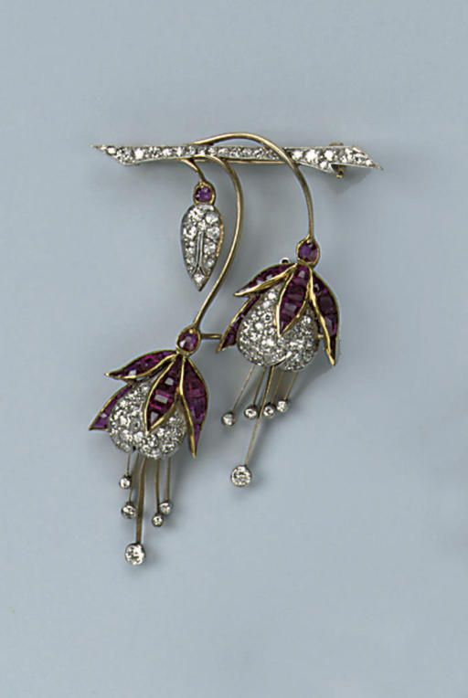 A RUBY AND DIAMOND BROOCH   Designed as a two fuchsia flowers, set with calibrated rubies and pavé-set circular-cut diamonds, circa 1920