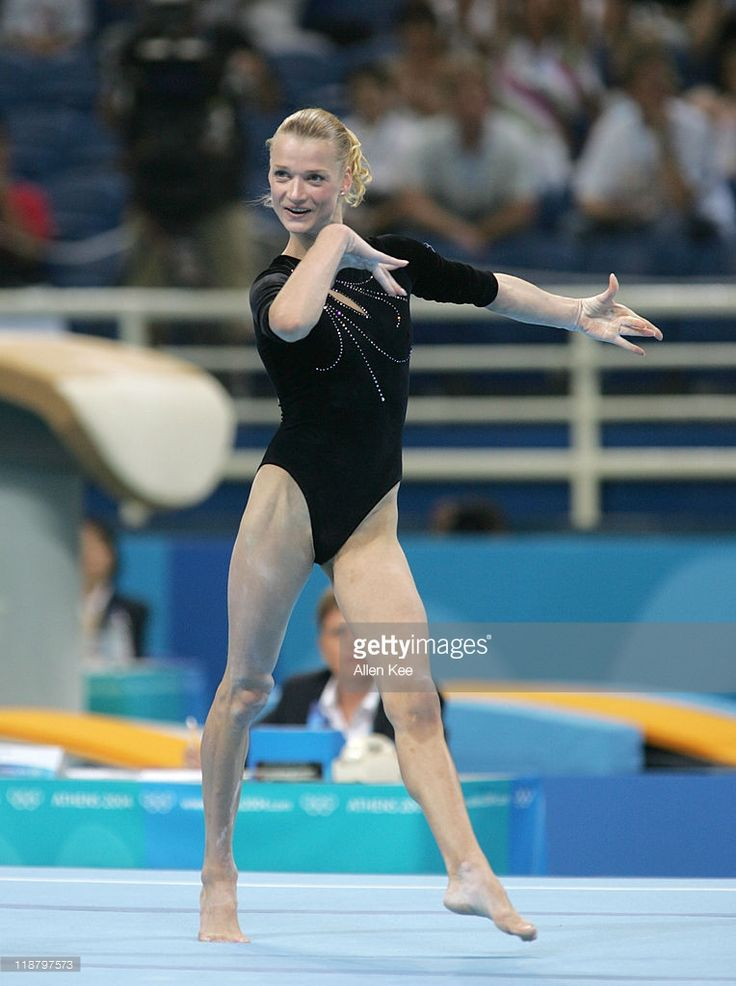 Svetlana Khorkina of Russia in the Women's Individual All-Around in the Olympic Indoor Hall at the Athens 2004 Olympic Games in Athens, Greece, August 19, 2004. Khorkina won the silver medal.
