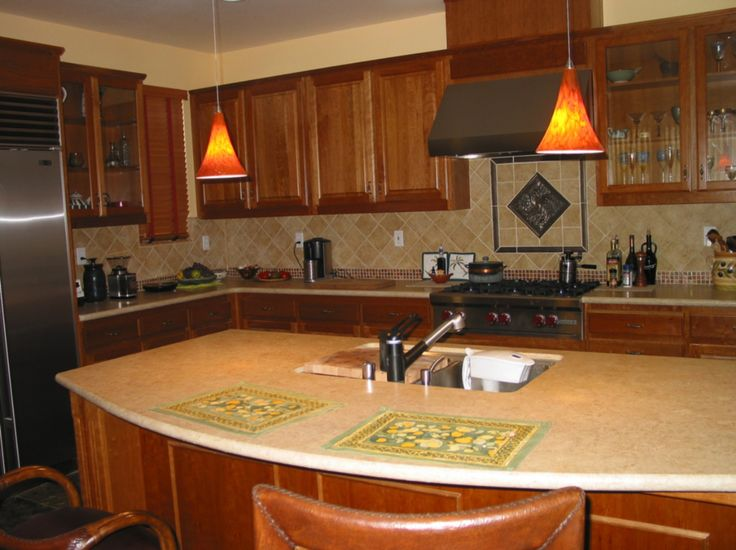Conventional Kitchen Island With One, Lengthwise Side Protruding To  Accommodate Two Diners.