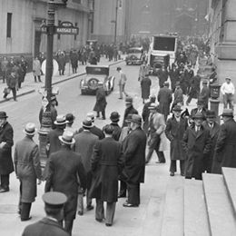 Crowds gather on Wall Street as banks reopened on March 13, 1933, after the Bank Holiday.