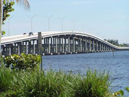 The Cape Coral Bridge over the Caloosahatchee River from Ft. Myers, Florida to Cape Coral.  I actually rode on the back of a motorcycle across this bridge once! Fun!