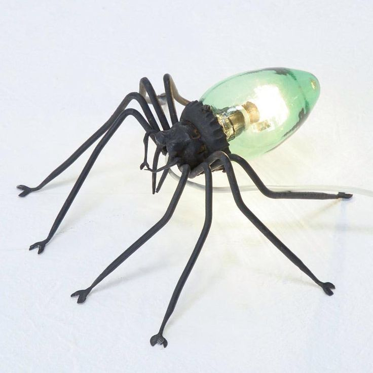 As Halloween night looms closer, we'd like to share some of our spookier design items. Sourced by @vintage_design_point, this spider lamp from the '70s is made of hand-forged iron and green glass. #halloween #spider #spiderlamp #70s #design #vintagedesign #lightingdesign #iron #glass