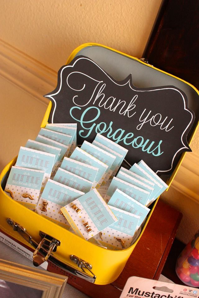 baby shower favors bow tie and mustache earrings for the guests to take home