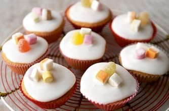 Mary Berry's iced fairy cakes are perfect for kids' parties and only need 15 minutes in the oven - easy peasy! This recipe shows you how to make a batch of 12, buttery fairy cakes and how to decorate them too with a simple icing and sweets. Get the kids to help you make these tasty fairy cakes, they can learn how to crack eggs and whip up a smooth, lump free icing to drizzle on top of your mini sponges. Mary Berry's iced fairy cakes recipe is taken from Mary Berry's Baking Bible.