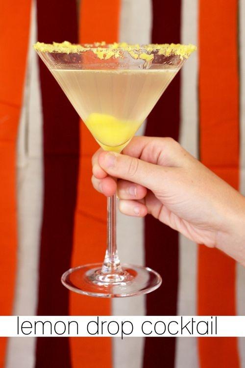 Lemon Drop Cocktail.  Needed: 4 ounces plain or citrus vodka, 8 ounces club soda, 4 tablespoons citrus simple syrup*, crushed lemon hard candies.