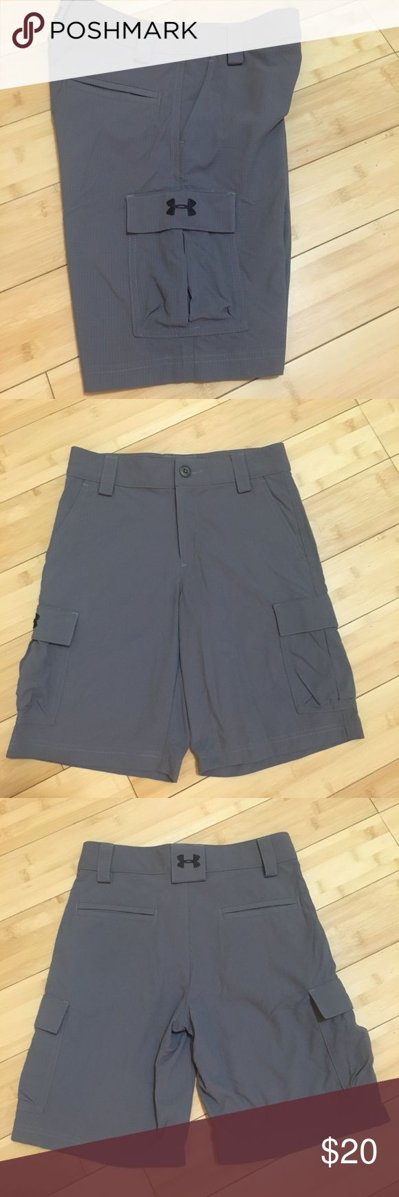 •Under Armour• Boys Cargo Shorts Under Armour Boys Size Medium (10/12) Cargo Shorts. Gray. Style # 1229256. Excellent Condition. 2 Front Slant Pockets, 2 Open Back Pockets, 2 Side Snap Cargo Pockets. 100% Ultra-durable 30+ SPF ripstop woven nylon. Internal adjustable waistband. Button and zipper closure. {{{ Bundle to save $$$$ }}} Smoke free home. Under Armour Bottoms Shorts