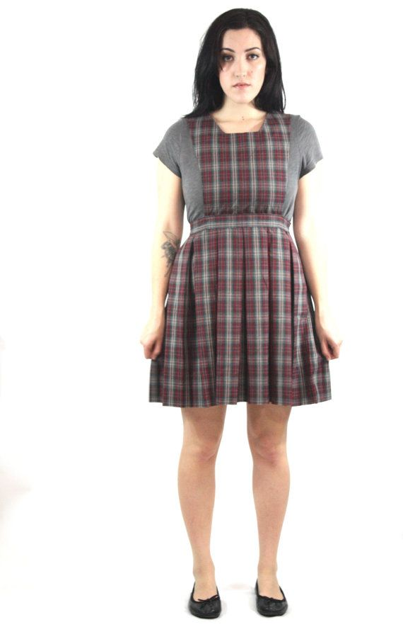 Classic little pinafore-style schoolgirl dress. Def. used to be part of a uniform. Stupid cute. Perfect condition. Kids 14 fits like womens S bust: 34 waist: 27 hips: free length: 33