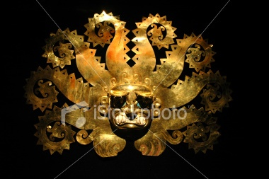 Peruvian ancient mask made out of gold Royalty Free Stock Photo