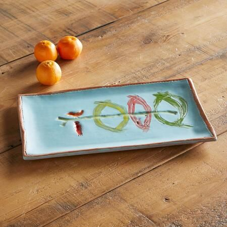 """SUNDANCE CERAMICS PLATTER - """"Birds perching in odd places"""" are a favorite motif of San Francisco ceramist Lisa Neimeth—an idea she explores with humor in entertaining ceramics exclusively for Sundance."""