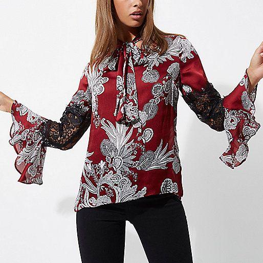 Rode blouse met kanten inzetstuk en bloemenprint