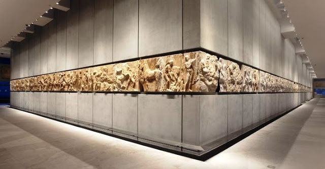 Final level of new Acropolis museum. Parthenon room exhibiting the frieze of Parthenon. Missing parts (destroyed or moved to British museum) are either totally absent or replaced with bright white plaster copies to showcase their absence.