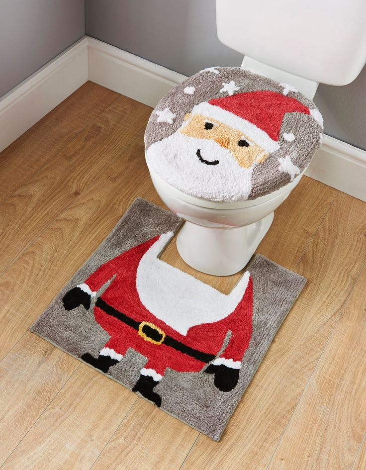 Add Christmas fun to your bathroom with this Santa toilet seat cover and pedestal mat set. Dimensions: Seat Cover: 45cm x 37cm. Pedestal Mat: 50cm x 50cm. To...