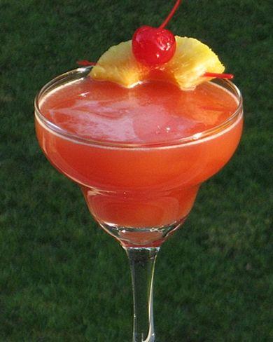 Psycho | 1.5 oz. Light Rum, .5 oz Galliano, 2 oz. Orange Juice, 2 oz. Pineapple Juice .5 oz Grenadine, Pineapple wedge and Cherry for garnish