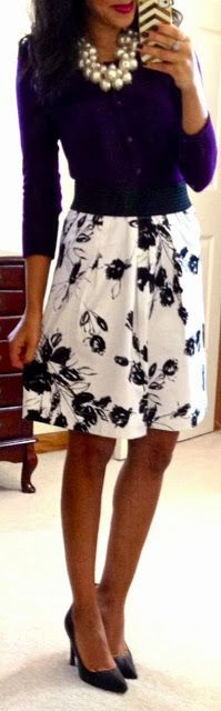 Purple top, floral printed midi skirt, heels, statement necklace all come together for one classy look.